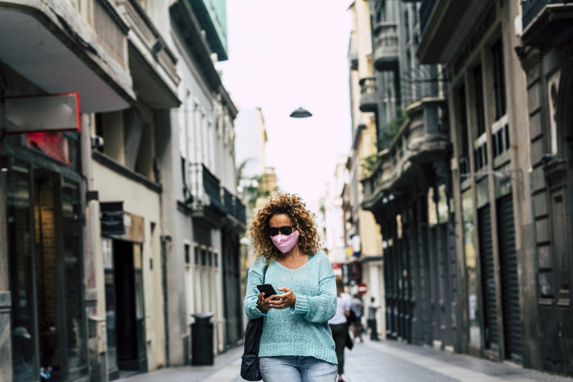 Woman check app and smartphone during corona virus